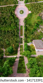 Flying drone above the park. View of the trees and walkways. Top view of the park. Ukraine Kiev victory park