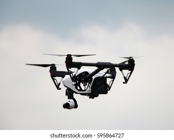 Flying drone with camera on the sky.