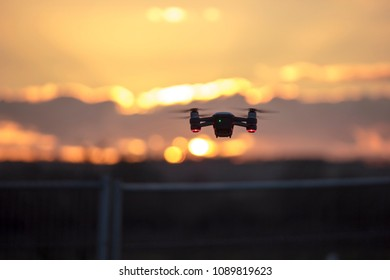 Flying drone during sunset with shallow depth of field