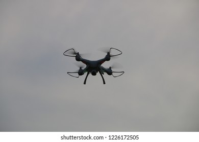 Flying with drone. Drone flying and floating above the camera Cloudy dark sky.