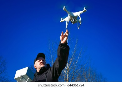 A flying drone into the sky.