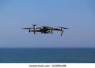 Flying drone over the sea