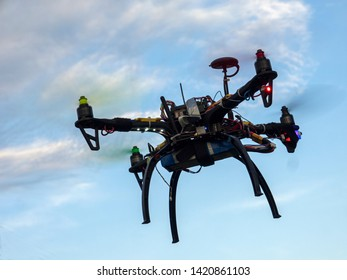 Flying drone with sky and clouds background