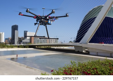 A flying drone without a camera with a blured out architectural ensemble of Valencia
