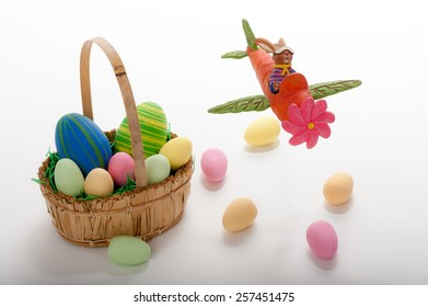Flying Easter bunny with Easter basket and eggs