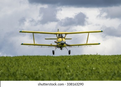 Flying the Fields/An aerial applicator sprays a field of green peas for insects.