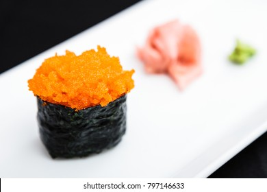 Flying fish roe masago on a plate with ginger and wasabi