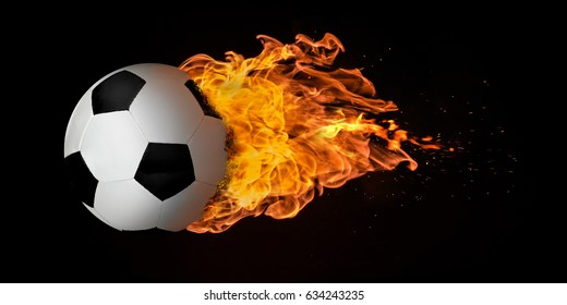 Flying football or soccer ball engulfed in trailing flames with sparks flying on a black background. Concept of a fiery competition or fast moving ball.