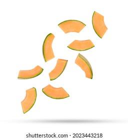 Flying fresh cantaloupe melon slices isolated on white background.