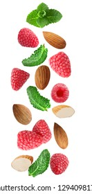 Flying fresh raspberry, almonds and mint leaves isolated on white background with clipping path as package design element and advertising. Full depth of field.