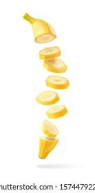 Flying fresh ripe banana slices isolated on white background