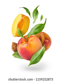 Flying fresh ripe peach with green leaves isolated on white background. Concept of food levitation, high resolution image
