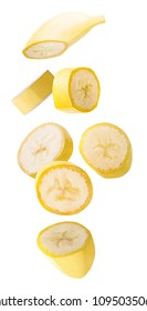 Flying fruit. Seven falling slised banana fruits isolated on white background with clipping path as package design element and advertising.