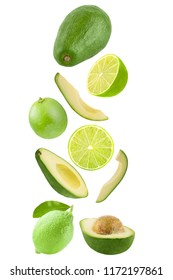 Flying fruits. Falling avocado and lime isolated on white background with clipping path as package design element and advertising. Floating fruits in the air.