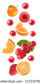 Flying fruits. Falling orange and red berries isolated on white background with clipping path as package design element and advertising. Floating fruits in the air.