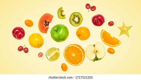Flying fruits healthy summer color background. Papaya, orange, kiwi, melon. Levitation, falling fly fruit. Tropical creative concept. Colorful fruity summertime vivid design