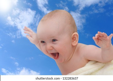 flying and funny toddler on a blue sky background
