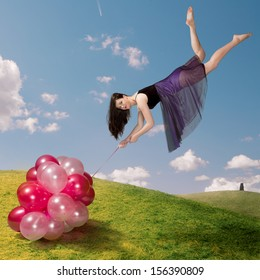 Flying girl holding colorful balloons