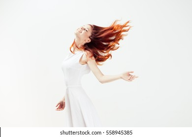 Flying hair woman on a light background