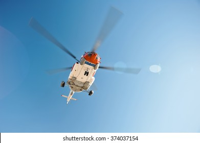 Flying helicopter near an oil platform