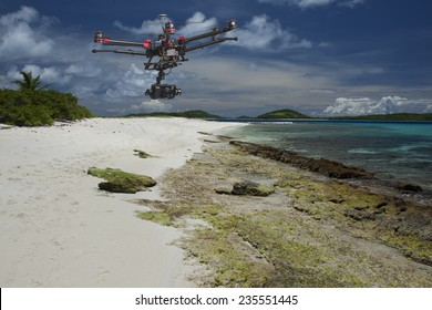 A flying helicopter with raised landing gears and a camera flying over white send of a beautiful Tropical Island with dramatic skies in the background