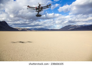 A flying helicopter with raised landing gears and a camera flying over mesmerizing view of Racetrack Playa