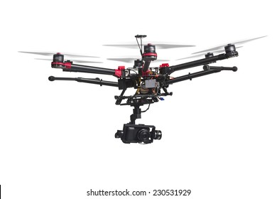 A flying helicopter with rised landing gears and a camera isolated on white background. Includes clipping path.