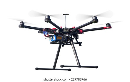 A flying hexacopter with spinning propellers without a camera shot from side isolated on white with clipping path