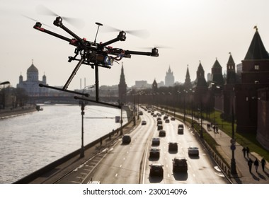 A flying hexacopter without a camera shot from a side with the a blured silhouette of Moscow in the background