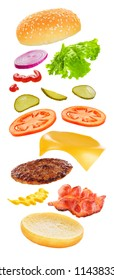 Flying ingredients of burger with cheese, bacon, pickles, tomato, onions and lettuce isolated on white background