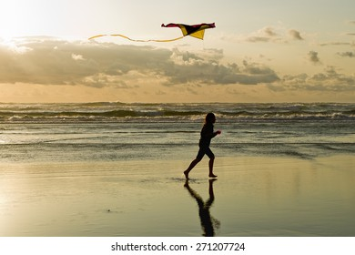 Flying a kite at the beach in Newport, Oregon.