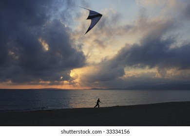 Flying a kite at sunset