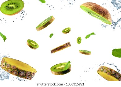 Flying kiwi and pineapple on white background. Kiwi and pineapple in motion. Tropical fruit concept.