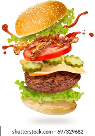 flying layers of bacon cheeseburger on white background