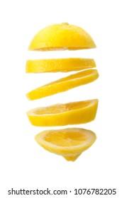 Flying lemon. Sliced lemon isolated on white background. Levity fruit