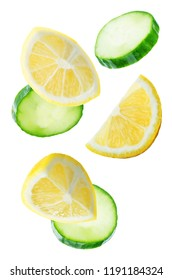 Flying Liemon slices with Cucumber slices on a white background. tinting. selective focus