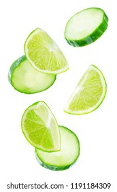 Flying Lime slices with Cucumber slices on a white background. tinting. selective focus