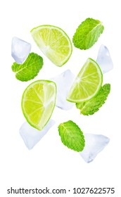 Flying Limes with ices and mint leaves on a white background. tinting. selective focus