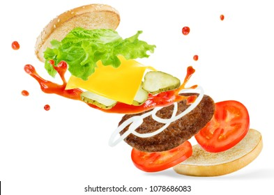 Flying meat Burger with ketchup splat isolated. toning