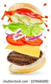 Flying meat Burger with mayonnaise and ketchup splat isolated. toning