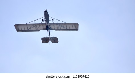 Flying microlight aircraft plane in clear sky. With space