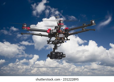 A flying multicopter with raised landing gears and a camera in beautiful cloudy skies
