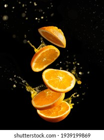 flying orange on a black background with splaches, vertical orientation