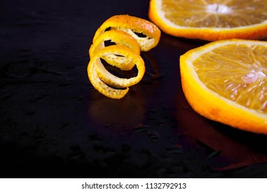 Flying orange. Sliced orange isolated on black background. Levity fruit floating in the air