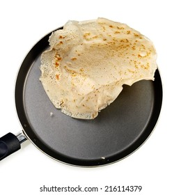 Flying pancake from a pan, top view