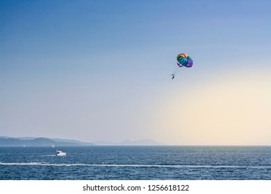 Flying in a parachute over Sanxenxo marine waters, Galicia, Spain