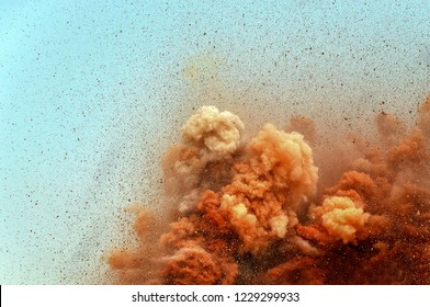 Flying particles of the rocks after the blast
