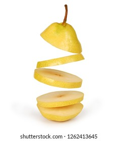 Flying pear. Sliced yellow pear isolated on white background with clipping path. Levity fruit floating in the air. Creative concept with flying fruits.
