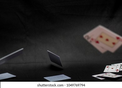 Flying playing cards. Black background