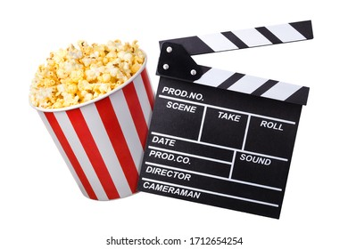 Flying popcorn and film clapper board isolated on black background, concept of watching TV or cinema.